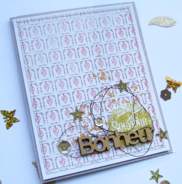 """Papiers du bloc Basi'like Chocolats, papier de la collection """"Noël d'Autrefois"""", sticker de la planche ST-0082 et mot bois """"bonheur"""""""